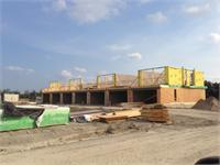 Construction photo of The Marquee Townhomes